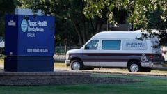 PHOTO: A medical transport van moves past Texas Health Presbyterian Hospital Dallas where a patient has been diagnosed with the Ebola virus, Sept. 30, 2014 in Dallas, Texas.