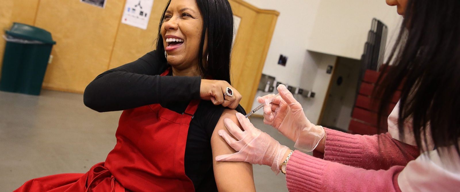 PHOTO: Cynthia Foreman receives a free flu shot from a Walgreens employee during a free flu shot clinic at Allen Temple Baptist Church, Dec. 19, 2014 in Oakland, California.