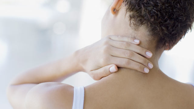 PHOTO: Holding your neck can be a signal for stress.