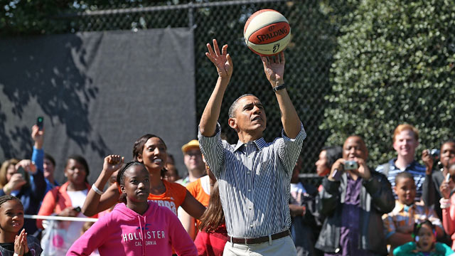 PHOTO: U.S. President Barack Obama plays basketball with children during the annual Easter Egg Roll on the White House tennis court April 1, 2013 in Washington, DC.