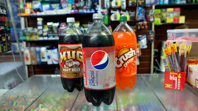 PHOTO: Large soda bottles for sale at convenience store in Chinatown, March 11, 2013, in New York. A New York state judge halted a controversial ban on large sugary drinks in places that serve prepared food that was to take effect, March 12, 2013.