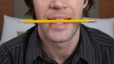 PHOTO: Pencil between teeth