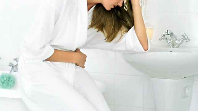 PHOTO: Woman with stomach cramps.