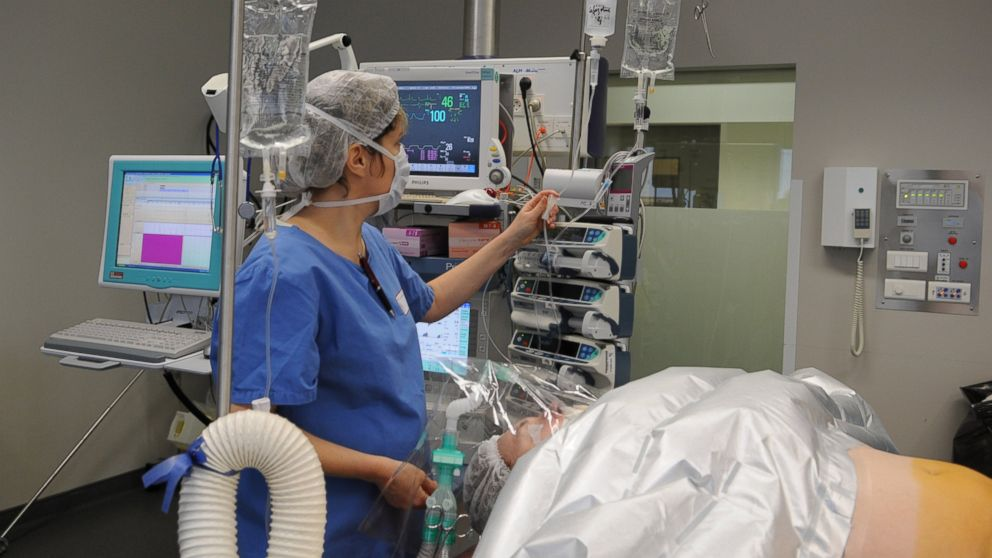 PHOTO: An anesthesiologist monitors her patient during sex reassignment surgery at Lyon Hospital in France on Nov. 5, 2011.