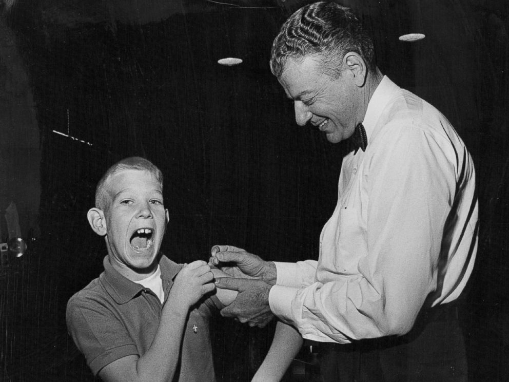 PHOTO: Paul Witzen, 11, of Colorado makes a face while he gets his smallpox vaccination on Nov. 8, 1963.
