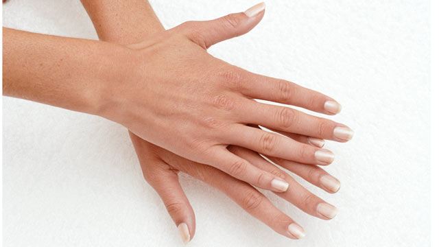 PHOTO: Agus says finger length is an indicator for risk of certain diseases.