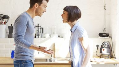 PHOTO: A couple having a discussion in the kitchen in this stock photo.