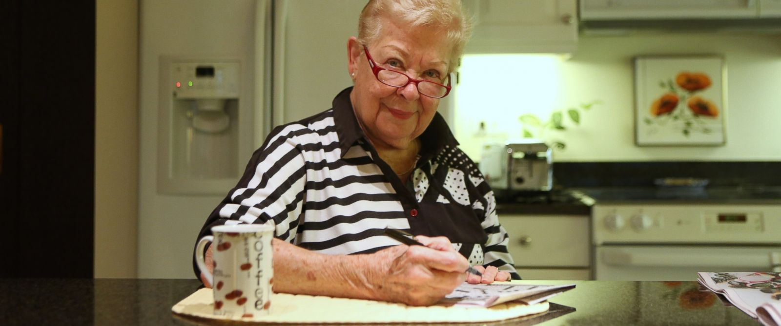 PHOTO: Barb Shaeffer, 85, works on one of the two crossword puzzles she does every morning in her kitchen in Chicago, Ill., on Aug. 16, 2012