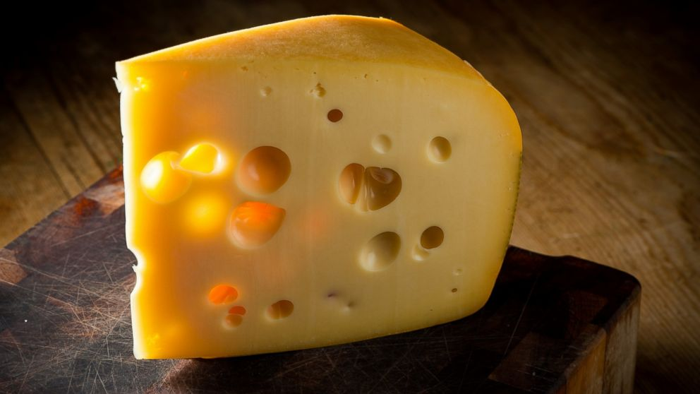 PHOTO: A new report explains where all the holes in Swiss cheese came from.