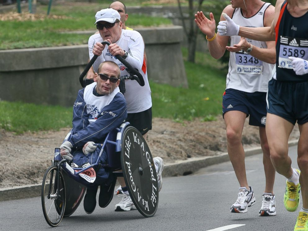 PHOTO: Dick and Rick Hoyt get encouragement from other competitors on Commonwealth Avenue near mile 25.4 during the running of the 110th Boston Marathon on April 17, 2006.