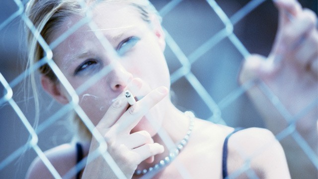 PHOTO: Teen girl smoking cigarette. The National Institute on Drug Abuse ...