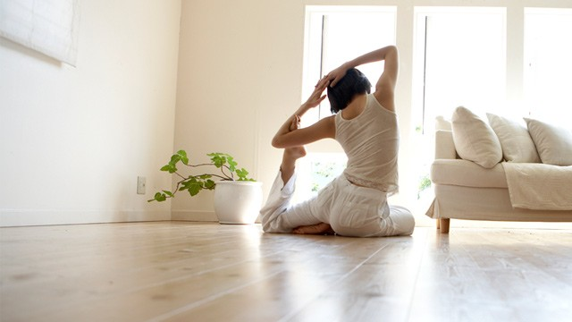 PHOTO: Woman doing yoga in living room