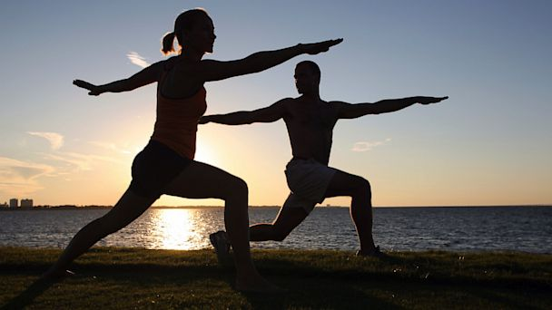 PHOTO: Couple practicing yoga