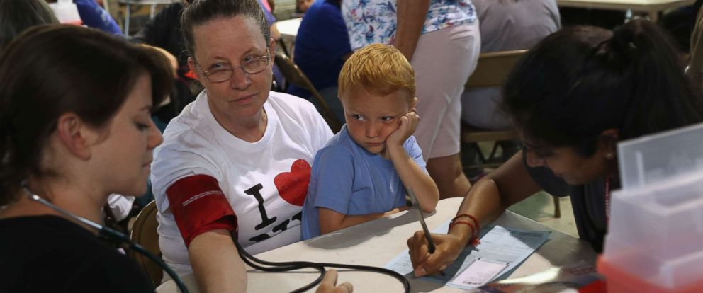 PHOTO: Ruby Partin, 63, and her adoptive son Timothy Huff, 5, visit a free helath clinic on July 22, 2017 in Wise, Va.