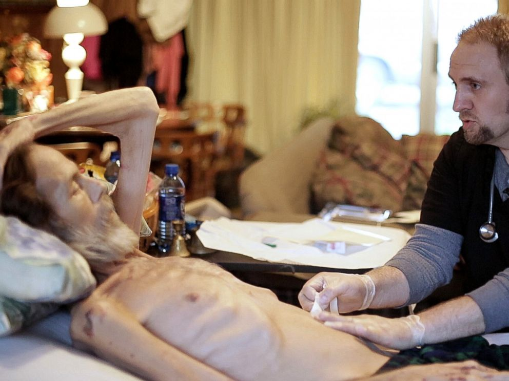 Jason Short cares for his patient Jeff in his home in Appalachia.