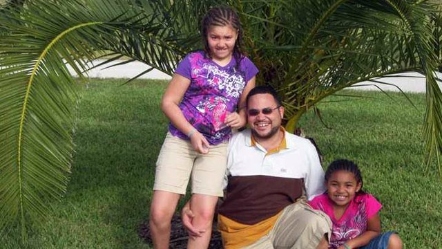 PHOTO: Reynard Zweifel of Kansas City, Mo., with his daughters Amaya, 11, and Leigha, 8.