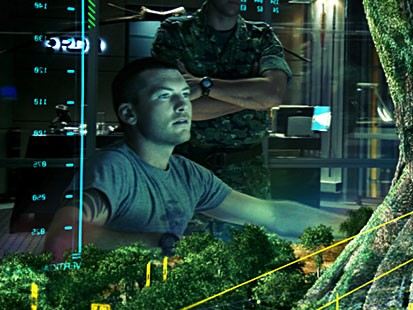 Jake (Sam Worthington) gets a virtual look at a massive, gnarled and ancient willow tree that is the Na'vi epicenter and an extension of their lifeblood in a scene from the movie