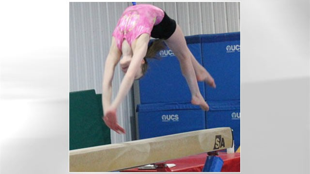 PHOTO: A young gymnast works the balance beam at Excel Gymnastics in Saugerties, New York.