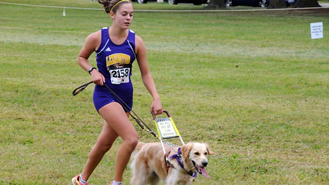 PHOTO: Blind racer Sami Stoner and guide dog