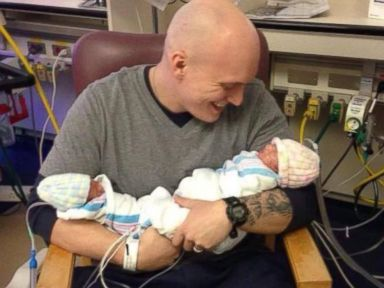 Brandon Hinman holds his two daughters, Azlynn and Kinliegh, in this undated photo posted to Facebook.