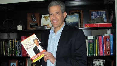 PHOTO: Dr. Richard Besser poses with his book, 'Tell Me The Truth, Doctor.'