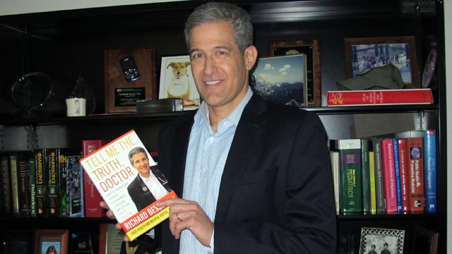 PHOTO: Dr. Richard Besser poses with his book, Tell Me The Truth, Doctor.