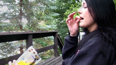 PHOTO: Mary, who is addicted to eating cat food, sitting outside eating cat food.