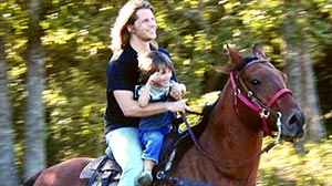 Photo: Rupert Isaacson says that his autistic son Rowan found healing power in the horses he rode during a family trip t