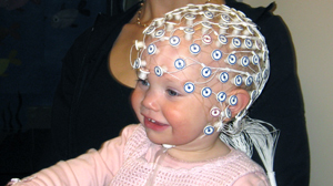PHOTO A baby gestures in a cognitive neuroscience laboratory at Children?s Hospital Boston.