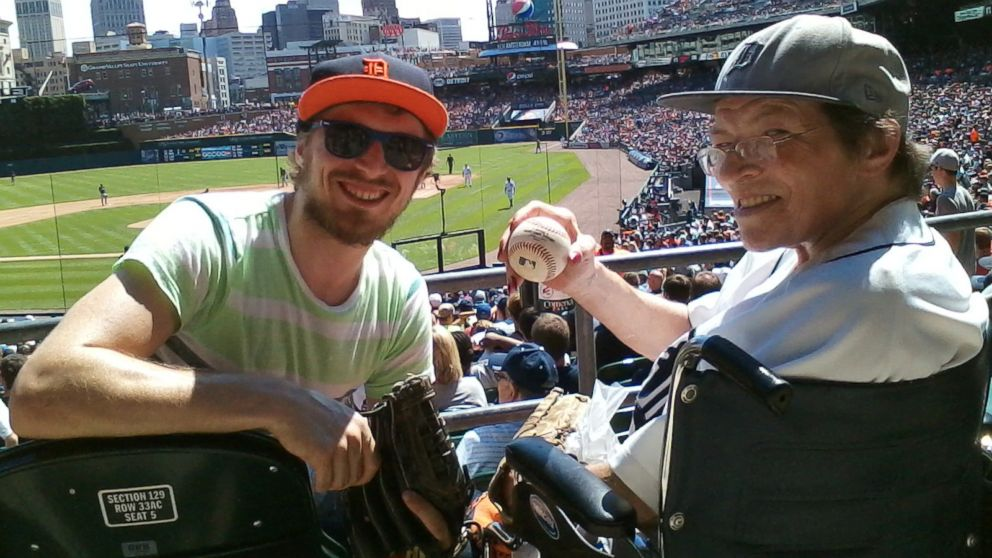 PHOTO: John Oberg caught a foul ball at a Detroit Tigers game and immediately handed it to his mom.