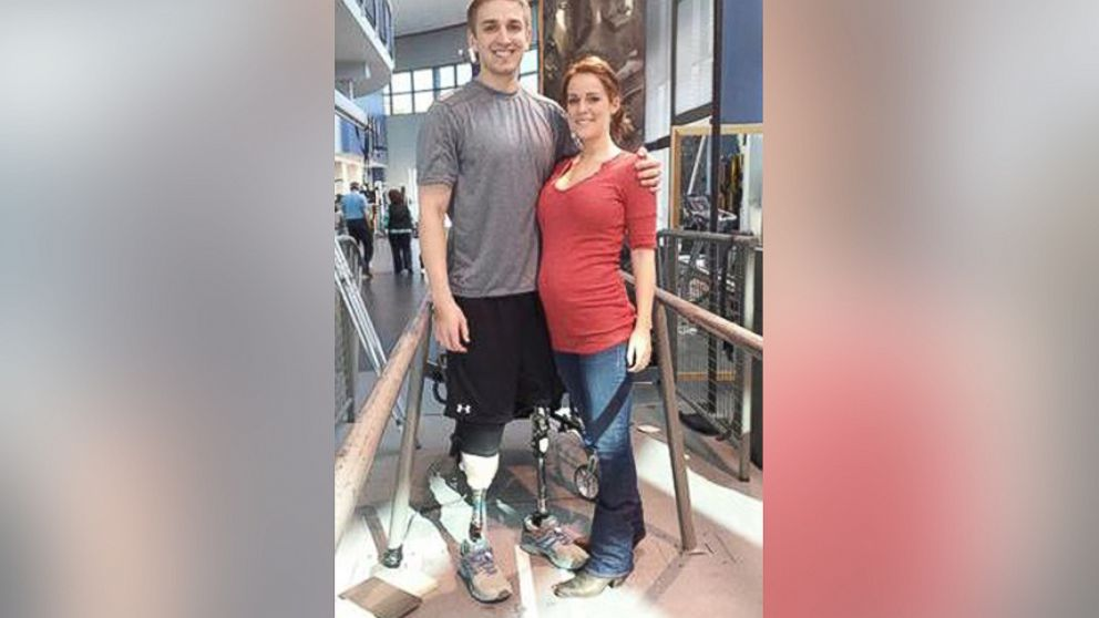 PHOTO: Josh Hargis stands on prosthetic legs alongside his expectant wife, Taylor Hargis, who is due in May.