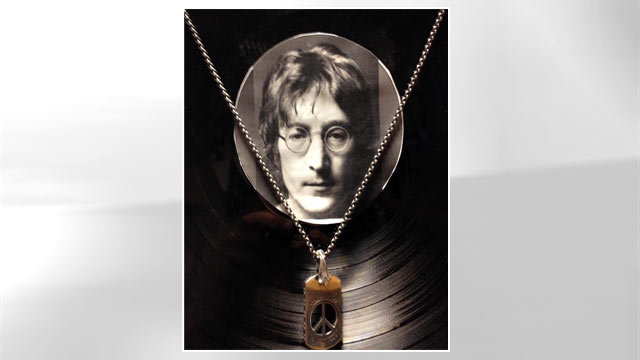 PHOTO: A pendant with a piece of John Lennons tooth in front of vinyl at the Castlepark Dental Centre in northeast England.
