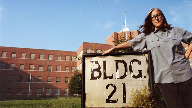 PHOTO: Filmmaker Lucy Winer poses outside Kings Park State Hospital in Long Island where she was a patient in the 1960s.