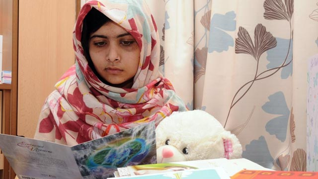 PHOTO: Malala Yousafzai reads cards from well-wishers as she recovers from surgery at the Queen Elizabeth Hospital Birmingham in the U.K.