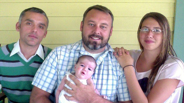 PHOTO: Mitch Stein, 36, with partner Hugo Horta, 33, left, and two daughters Devynn Stein, 15, and Tuolumne Horta-Stein, seven weeks, in Pomona, Calif., where he was fired last August from his coaching job.