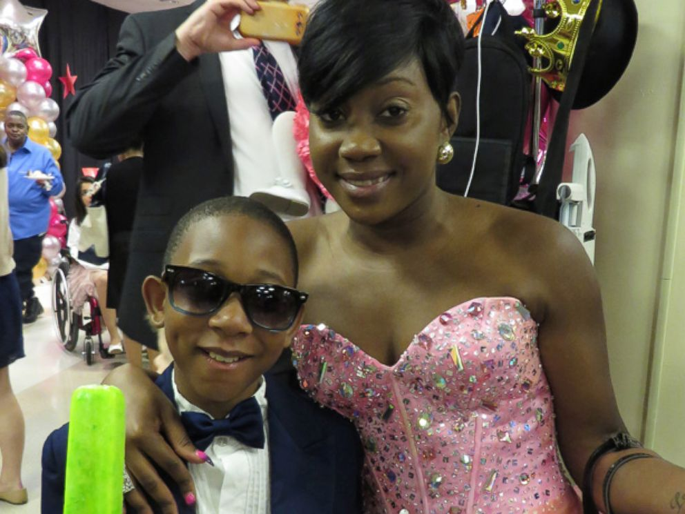 PHOTO: Dressed to the nines, these two Pediatric Prom attendees grabbed a few treats.