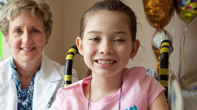 PHOTO: 8-year-old Precious Reynolds and Dr. Jean Wiedeman.