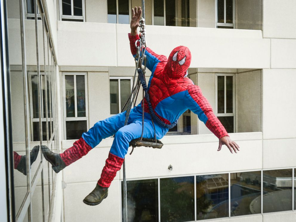 Spiderman posed outside the windows of Childrens Medical Center Dallas.