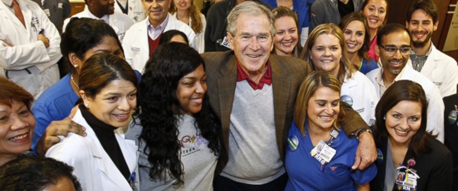 PHOTO: Former President George W. Bush walks into Texas Health Presbyterian Hospital Dallas on Nov. 7, 2014, where he visited with caregivers.