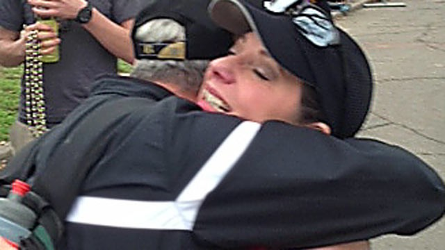 PHOTO: Toni Wild, 50, gets a hug at the finish line of her first marathon in New Orleans, Feb. 24, 2013, four years after her heart transplant.