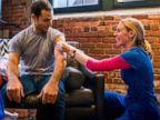 PHOTO: Registered Nurse Kate Dicker gave Kevin Flynn a flu shot as part of the UberHEALTH pilot program.