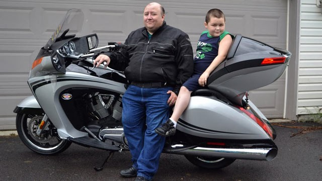 PHOTO: Stay-at-home dad Wayne Moyer, shown with son Matt, says his bike is his