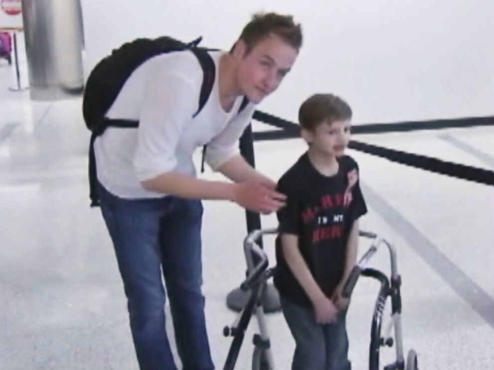 PHOTO: Grant Berg, 8, meets Marvin Zumkley, a German college student who donated bone marrow to Berg three years ago, at Los Angeles International Airport on May 3, 2015.