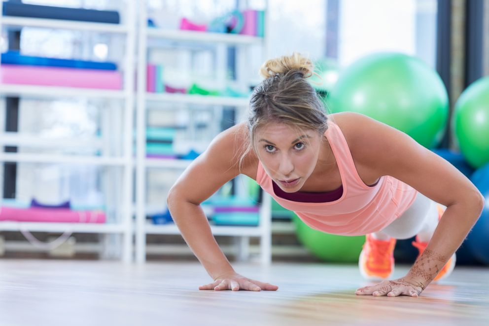 PHOTO: A woman does push ups while working out in a gym in this stock image.