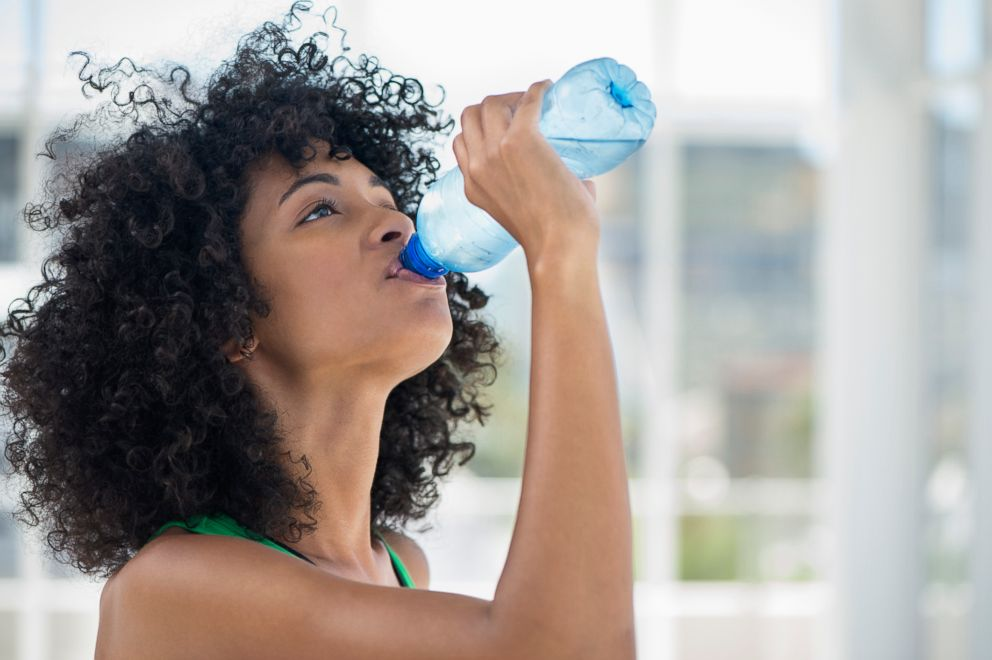 PHOTO: A woman is drinking more water for a new years resolution seen in this stock image.