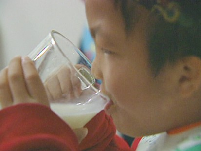 boy drinks milk