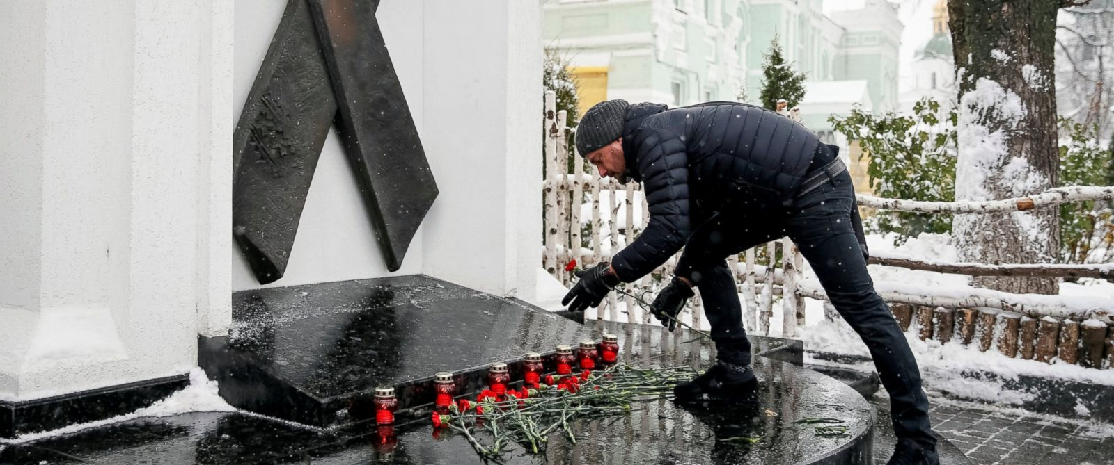 PHOTO: A participant lays flowers as he takes part in a ceremony to mark World AIDS Day near a monument in memory of AIDS victims in Kiev, Ukraine Dec. 1, 2016.