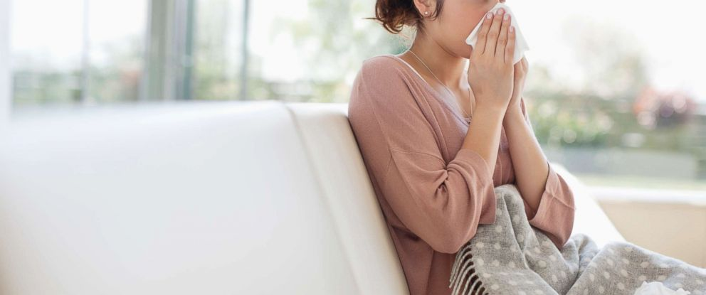 PHOTO: A sick woman blows her nose in this undated stock photo.