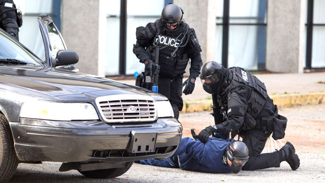 PHOTO: Members of a SWAT Team apprehend a bank robber during Urban Shield, a multi-agency, 24-hour training event where different scenarios are played out in different venues.