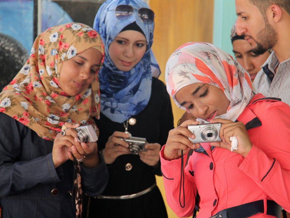 PHOTO: Young Syrian refugees in the Zaatari refugee camp in Jordan learn to take photographs.